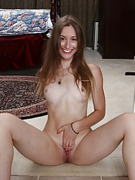 Natural coed Lilith Black spreads her hairy pussy pictures at freekilosex.com
