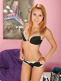 Super cute coed Madina Angel spreads her little flower pictures at find-best-tits.com