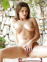 Busty brunette Cintya Doll masturbates on the patio pictures