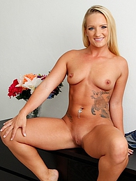 Tattooed blond Cali Carter exposes her juicy ass pictures at find-best-panties.com