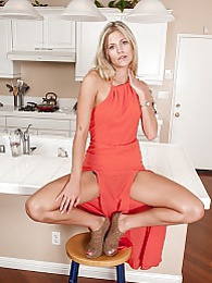 Stunning blond Scarlet Red fingers her tight pussy pictures at freekilopics.com