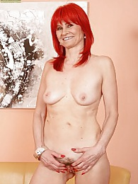 Older redhead Amanda Rose fingers hairy pussy pictures at lingerie-mania.com