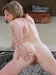 Busty mature amateur Kathy Gilbert rubs shaved pussy pictures at find-best-ass.com
