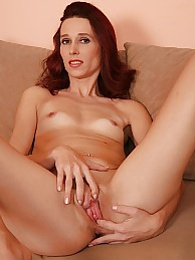 Tall MILF Rebecca Red toys her tight pussy on the sofa pictures at lingerie-mania.com
