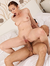 Mature redhead Violet Jones bounces on his hard cock pics