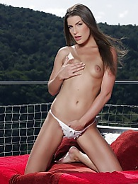 Gorgeous babe Zena Little strips naked on the balcony pictures at kilovideos.com