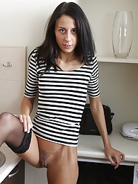 Gorgeous babe Elizabete masturbates in kitchen pictures at adspics.com