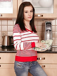 Perky titted coed Melisa Black masturbates in kitchen pictures at freekilosex.com