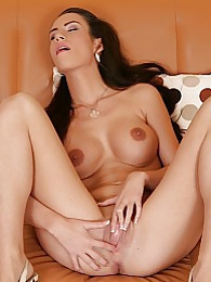 Busty babe Lola Wan stuffs multiple fingers in her twat pictures at relaxxx.net