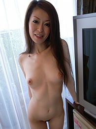 Yuu strips her clothes to show her perfect tits and take a cock inside her hairy pussy pictures at freekilosex.com