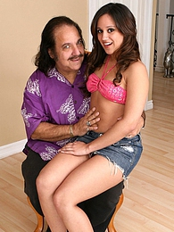 Lynn Love sits on top of her old stepdaddys lap before she screws him on the couch pictures at lingerie-mania.com