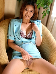 Naughty Japanese model Maya Tsubaki teases us with a nice upskirt and exposes her hairy pictures