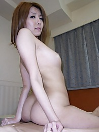 Yuna Hirose gives our cock a nice sucking and straddles on top to give it a ride pics