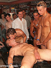 Wild and crazy gay men in an oiled up groupsex orgy party pictures at lingerie-mania.com