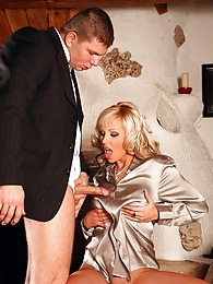 A hot clothed couple loves shagging in their living room pictures at freekilosex.com