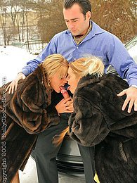 Hot blonde babes wearing fur sucking cock outside in snow pictures at lingerie-mania.com