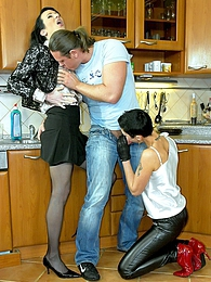 Hotshot banging two clothed babes in a big kitchen hard pictures at freekilosex.com