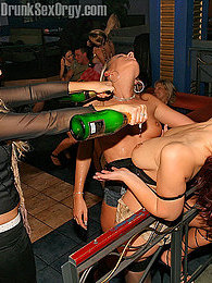 Lesbian babes inserting with a beer bottle in friends pussy pictures at adipics.com