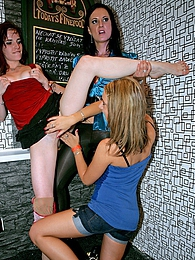 Hot clothed girls rubbing fake cocks at a crazy sex party pictures at freekiloclips.com
