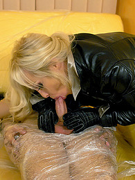 A clothed blindfolded blonde sucking his massive pecker pictures at lingerie-mania.com
