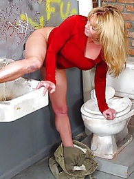 Blonde MILF Kiss sucks off black dick in gloryhole pictures at kilogirls.com