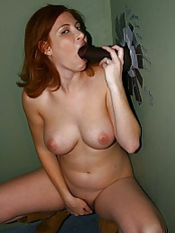 Redhead Ginger Blaze sucks off black in pornshop gloryhole pictures at find-best-lingerie.com