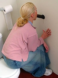 Blond Jamie Brit sucks off black in bathroom gloryhole pictures at find-best-panties.com