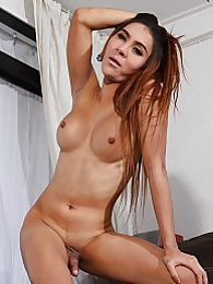 Exotic Mickey stripping and posing pictures at freekilosex.com