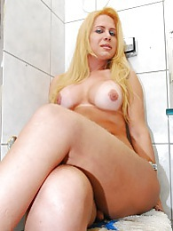 Blonde TS cutie Renata posing in the bathroom pics