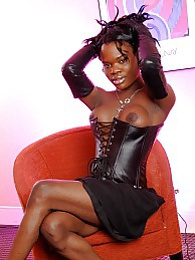 Ebony tgirl Elexa posing in hot leather corset pictures at lingerie-mania.com