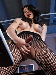 Sexy Teighjiana toying in net body stocking pictures at lingerie-mania.com