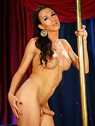 Pretty Danika strip dancing by the pole pictures
