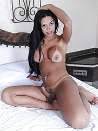Busty Juliana strips and plays on the bed pictures at lingerie-mania.com