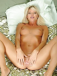 Gorgeous MILF Niki Lee Young toys her juicy pussy pictures at lingerie-mania.com