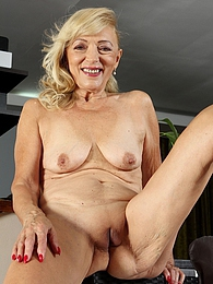 Horny granny Janet Lesley spreads her older pussy pictures at freekiloclips.com