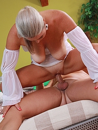 Busty older babe Lina Peters riding his big cock pictures