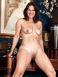 Older office babe Kaysy strips naked on her desk pictures at dailyadult.info