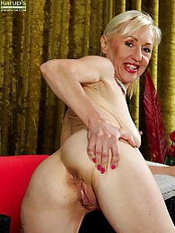 Horny granny Tina spreads mature pussy wide open pictures at freekiloporn.com