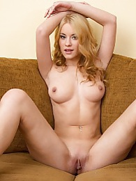 Strawberry blonde Arianna May strips butt ass naked pictures