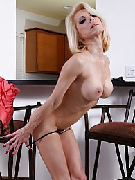 Busty blond cougar Jodie Stacks fingers her pussy pictures at freekilosex.com