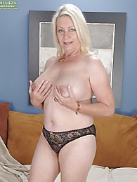 Horny granny Angelique spreads her older pussy pictures at lingerie-mania.com