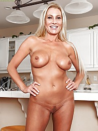 Busty mature goddess Jennifer Best naked on island counter pictures at freekilosex.com