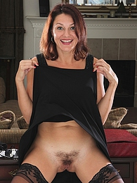 Hairy mature babe Ava Austin wearing only stockings pictures at lingerie-mania.com