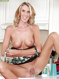 Brynn Hunter spreads her pussy in the kitchen pictures at freekilomovies.com