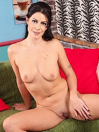Brunette MILF Evan Jones fingering her juicy pussy pictures