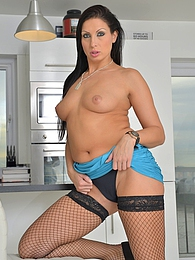 Stunning MILF Nikkitta naked in black fishnets pictures at lingerie-mania.com