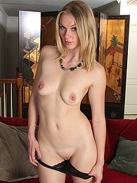 Leggy MILF Ava Michelle exposes her shaved pussy pictures at lingerie-mania.com