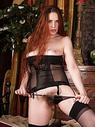 Older redhead Mistique spreads her beautiful ass pictures