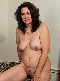 Mature Latina Gianna Jones spreads her hairy pussy pictures at lingerie-mania.com