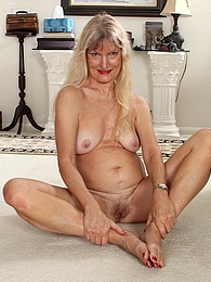 Blonde cougar Lisa Cognee plays with her older twat pictures at adipics.com